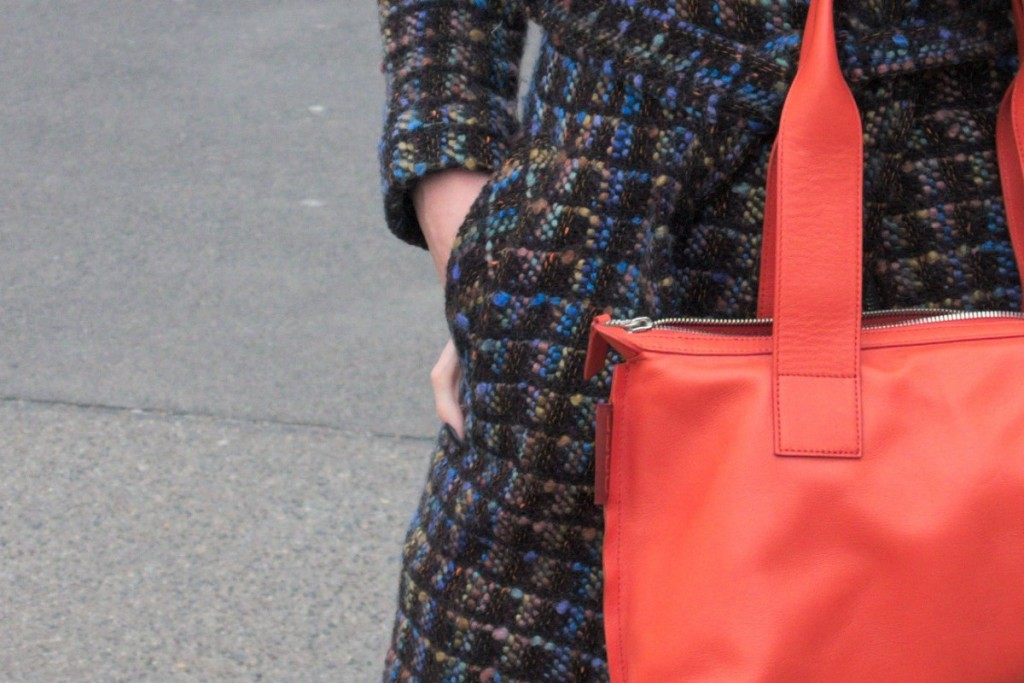 Blue and orange bouclé coat by moods of Norway and orange cow leather bag by Bree