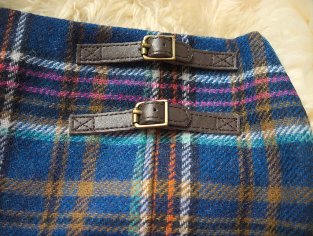 Navy, brown and pink Boden tweed check kilt with faux leather buckle detail