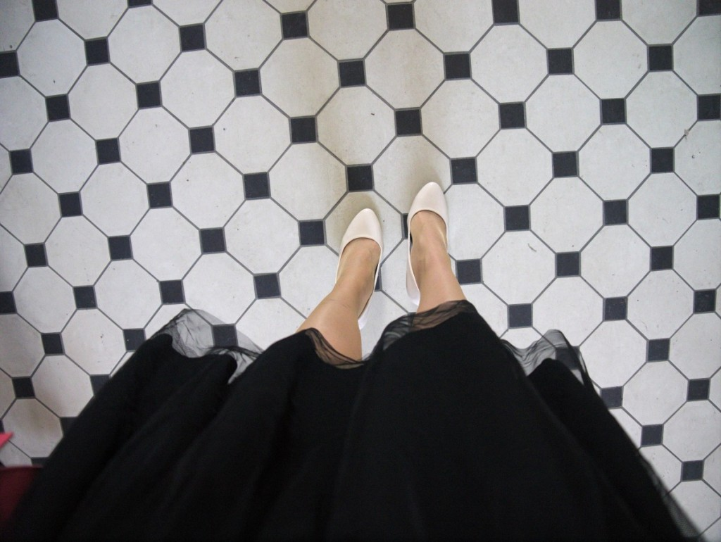 Black and white tiles and cream pumps