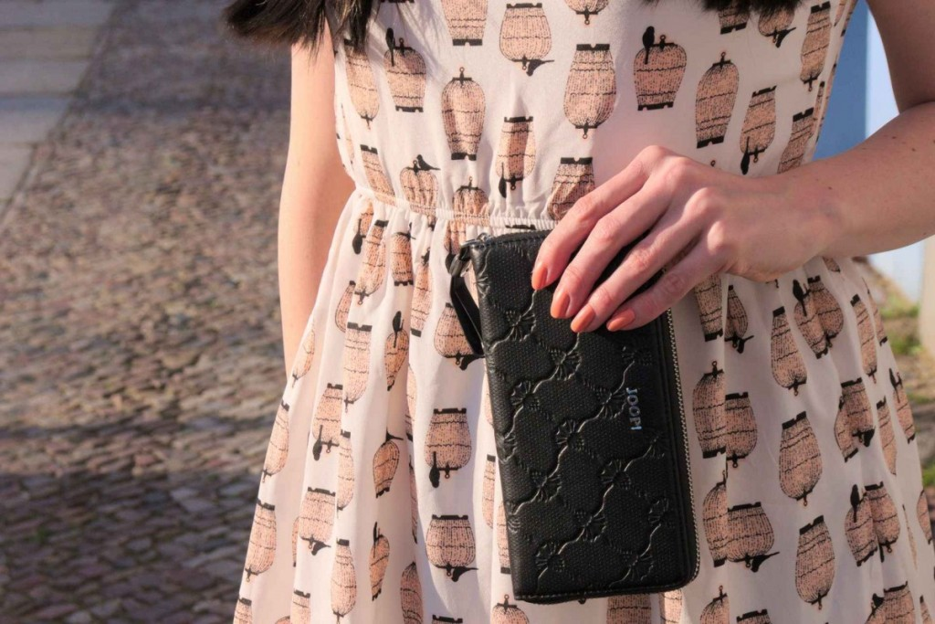 Birdcage print pastel dress and black signature cornflower clutch