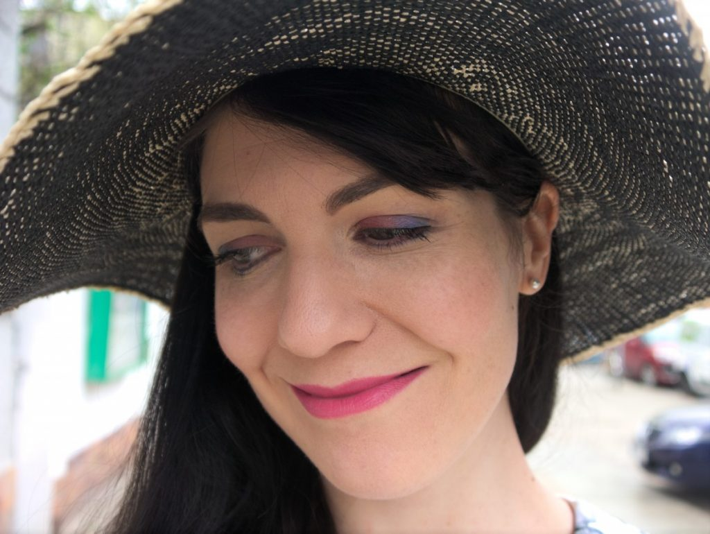 blue and pink eyeshadow and straw hat