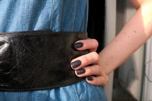 belted waist and dark nailpolish