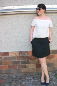 white off shoulder blouse and black skirt