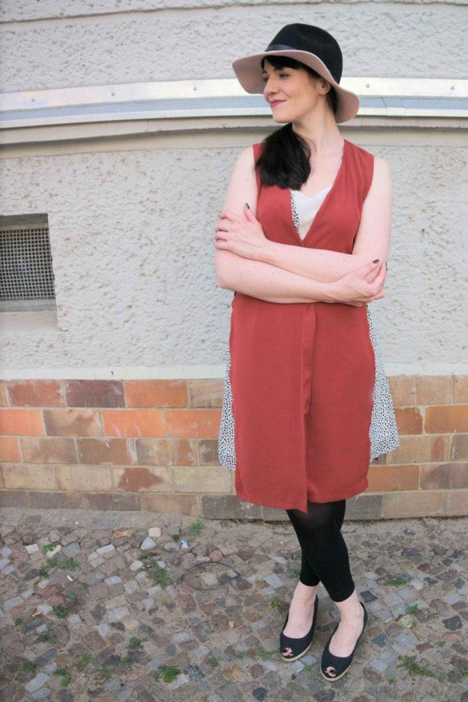 longline vest and fedora