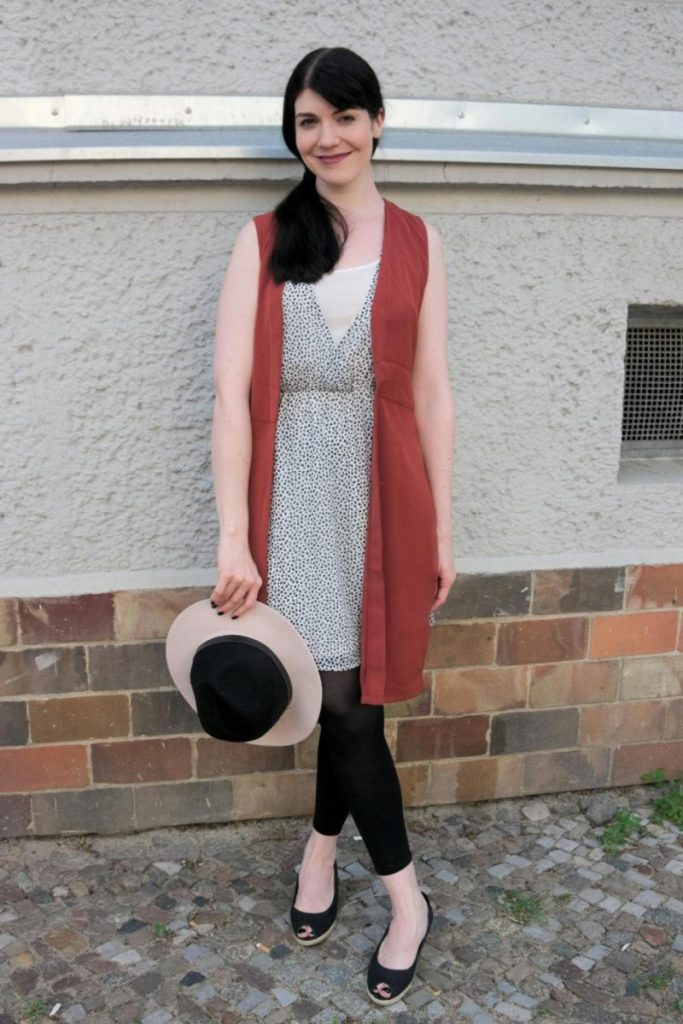 long vest and fedora