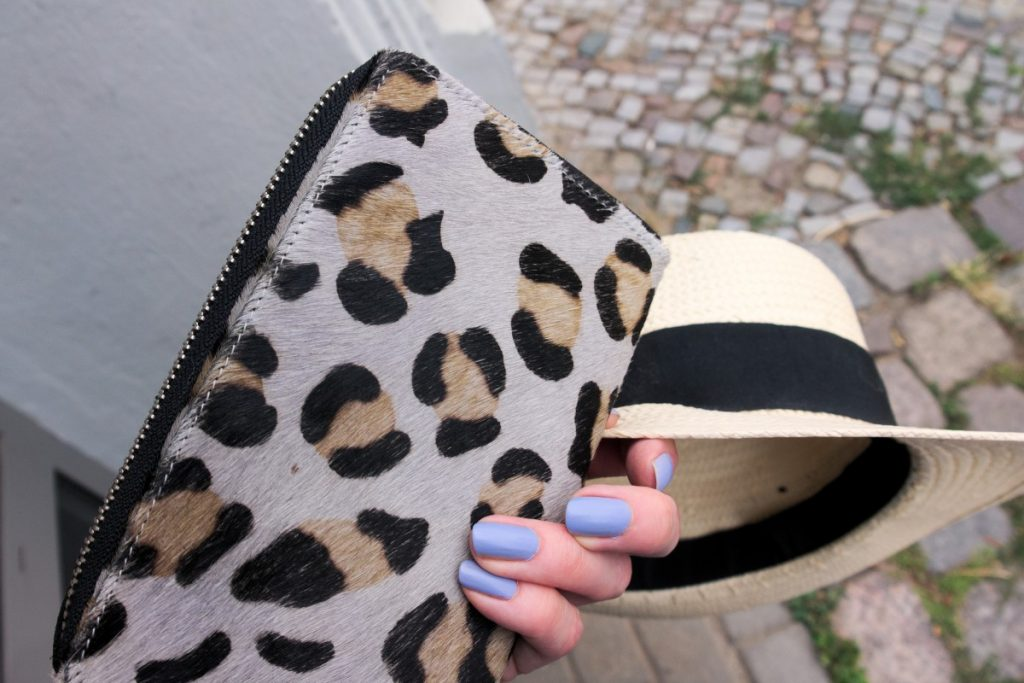 leopard clutch detail and straw hat