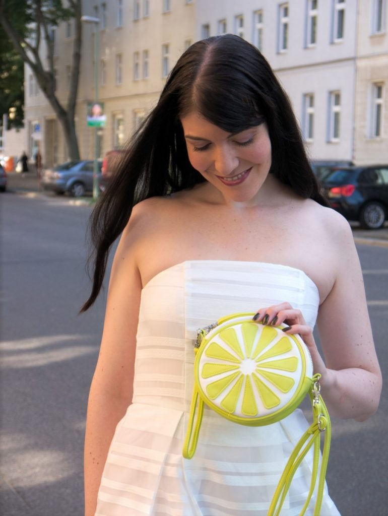white organza dress and lemon bag