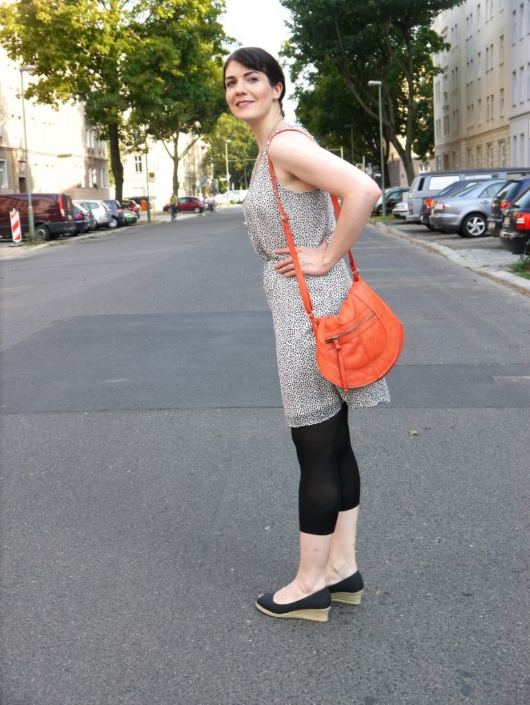 the orange statement bag
