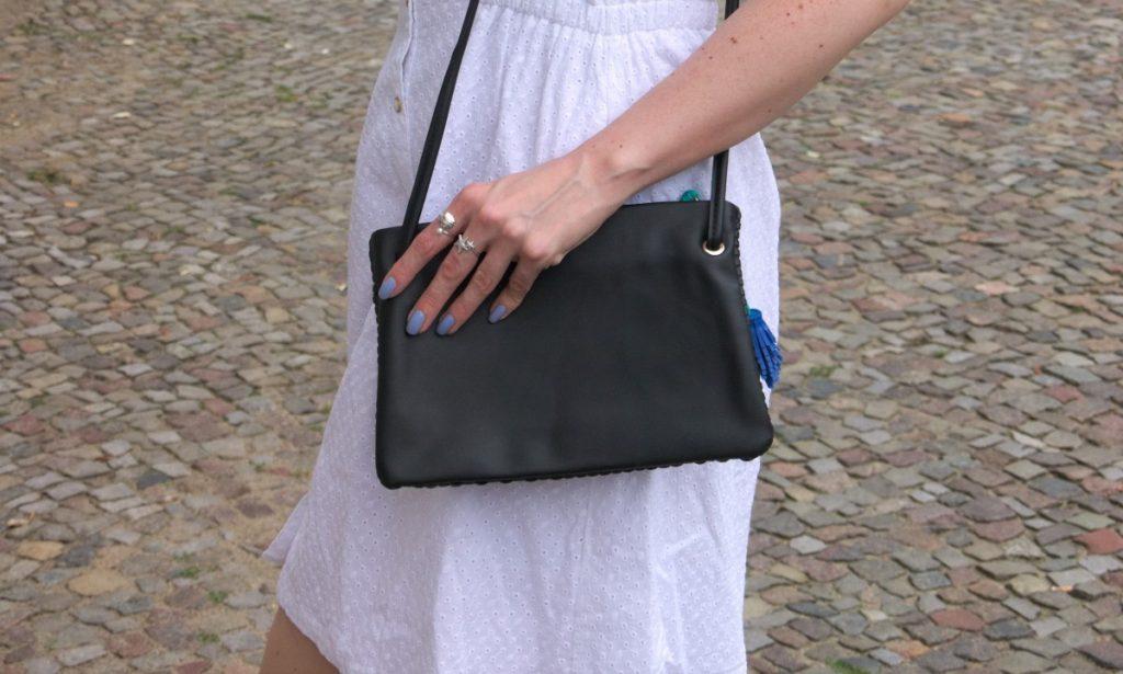 white cotton dress and tassel bag