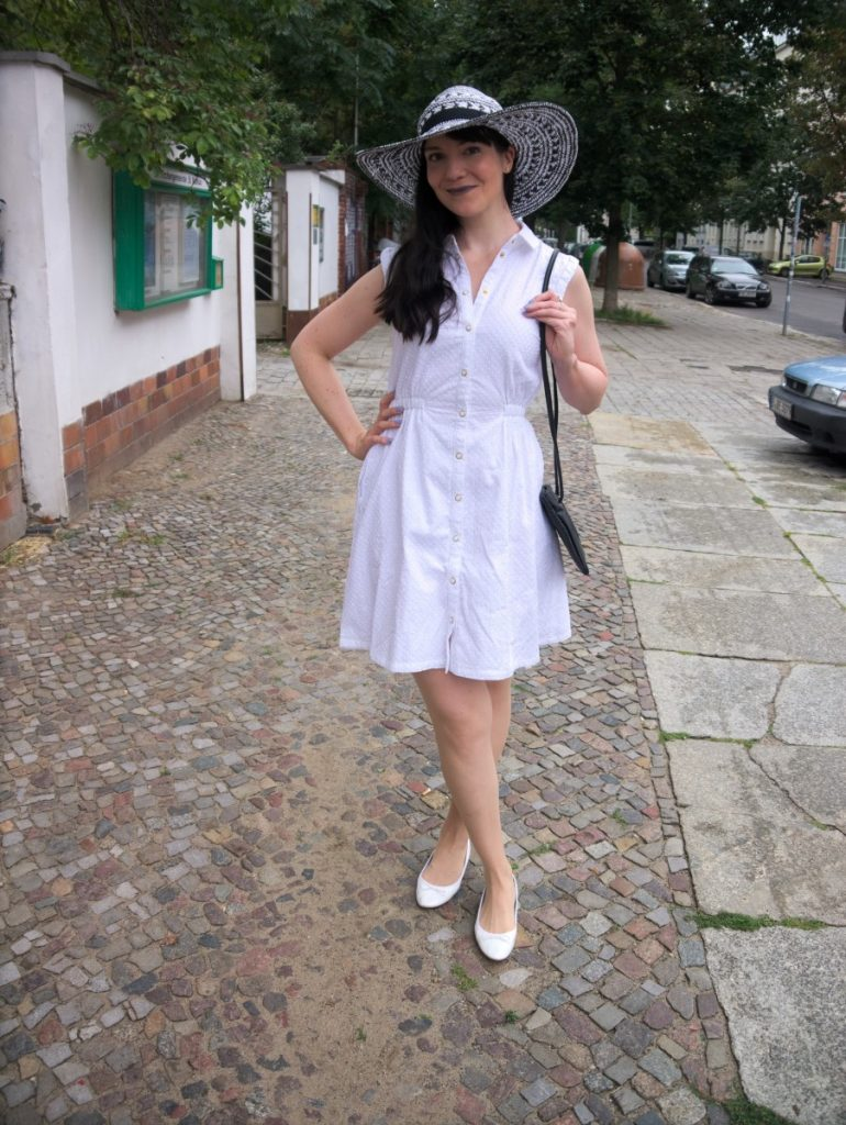 white cotton dress and straw hat