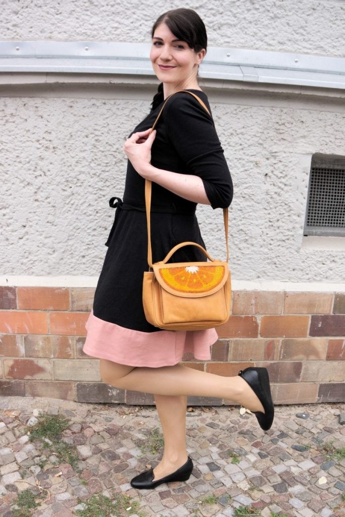 jersey dress and orange bag