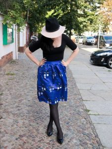cobalt blue Tardis skirt and fedora