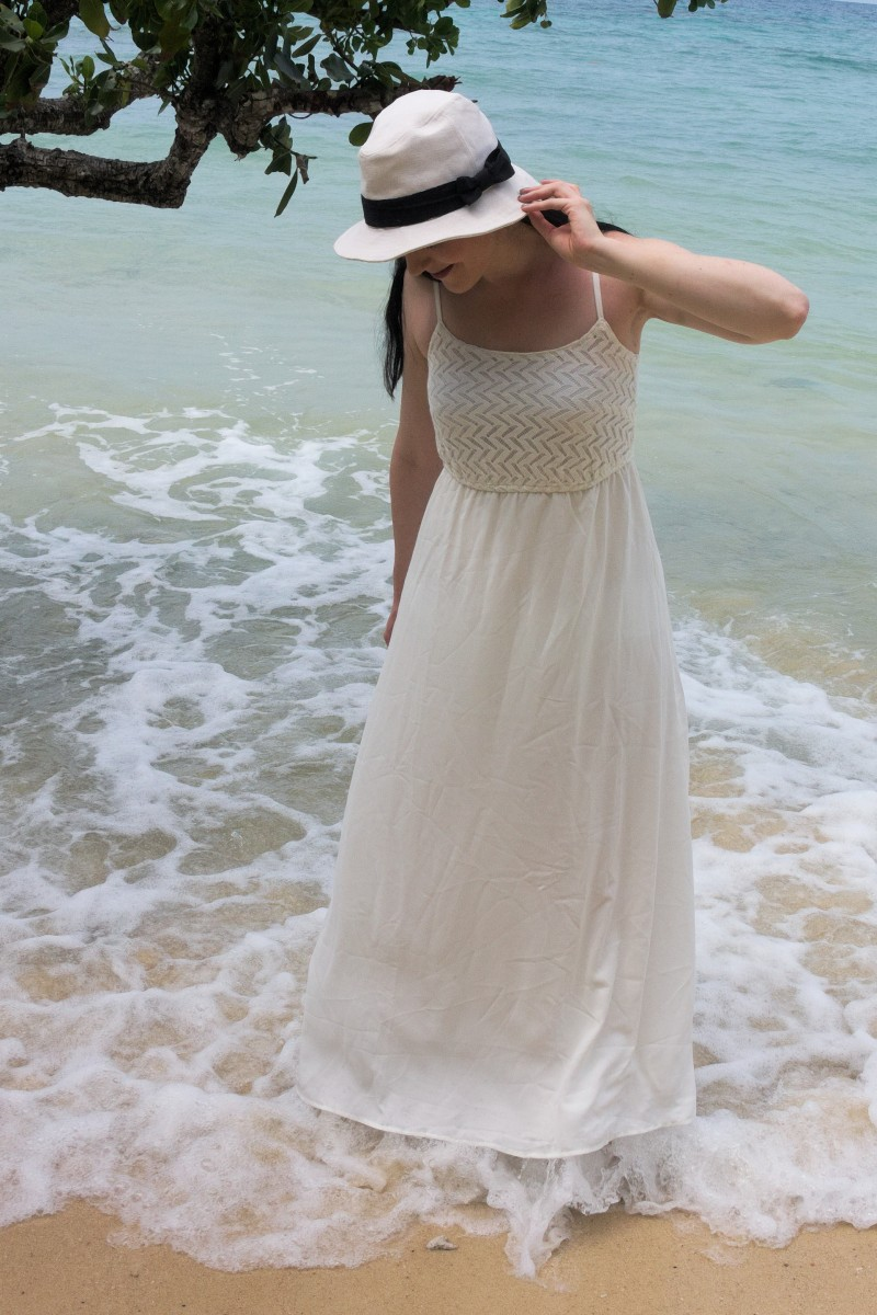 white maxi dress on white beach