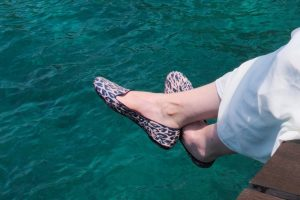 leopard slippers and blue sea