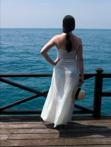 white dress and blue sea