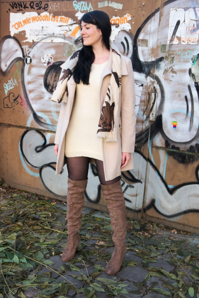 khaki overknee boots and cream coat