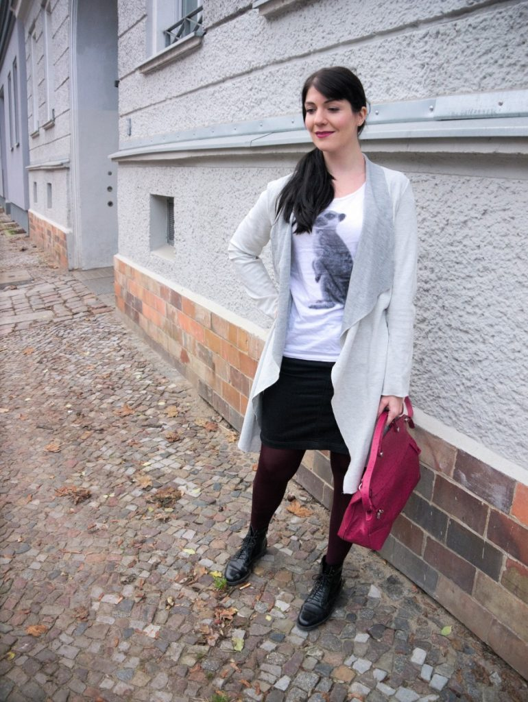 casual winter work wear outfit with pixel meerkat shirt and ostrich bag