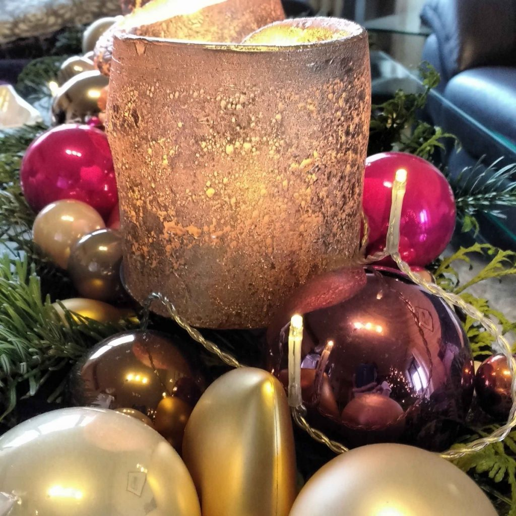 golden candle and christmas ornaments