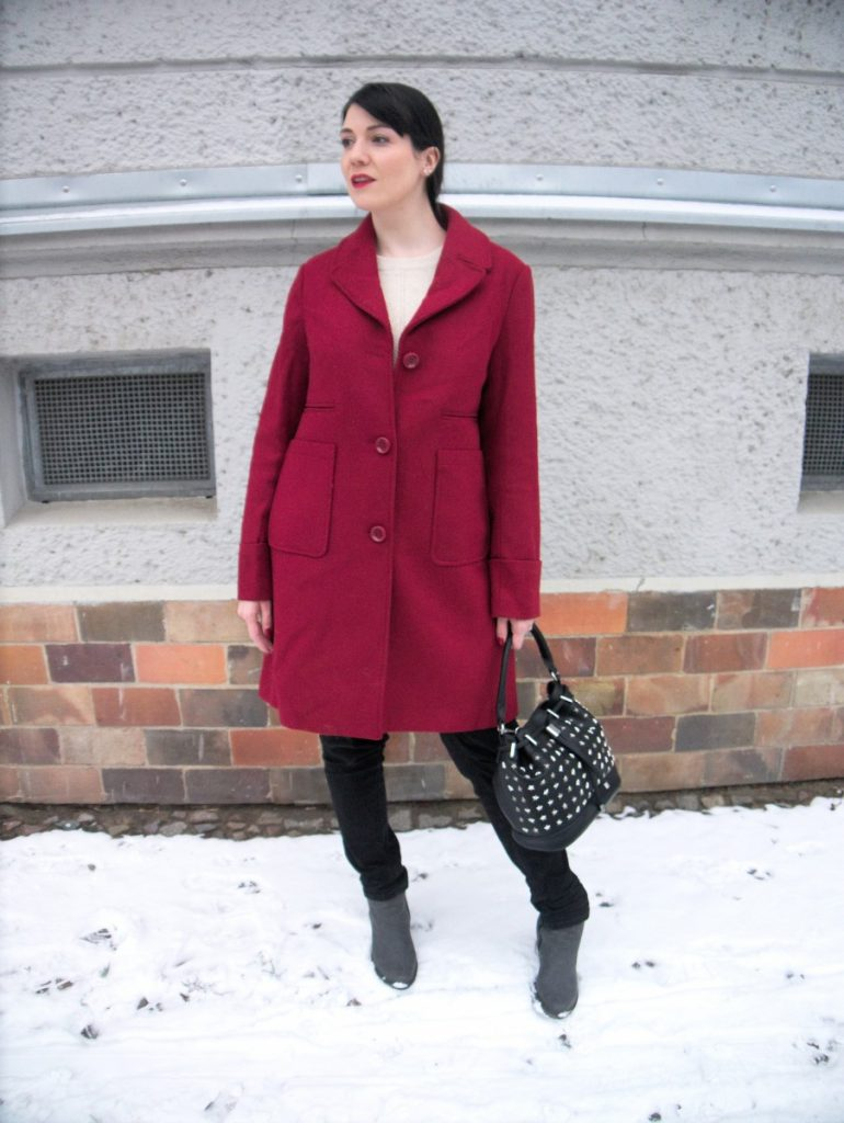 red coat and peplum sweater