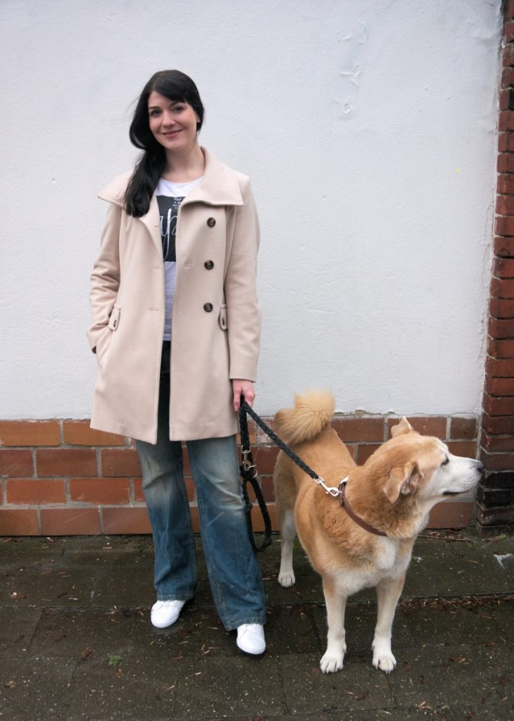 cream wool coat, akita and sneakers