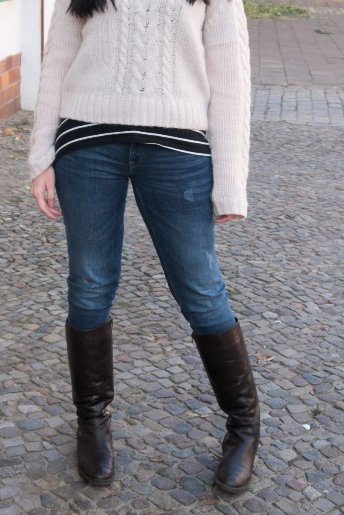 cable sweater and brown leather boots