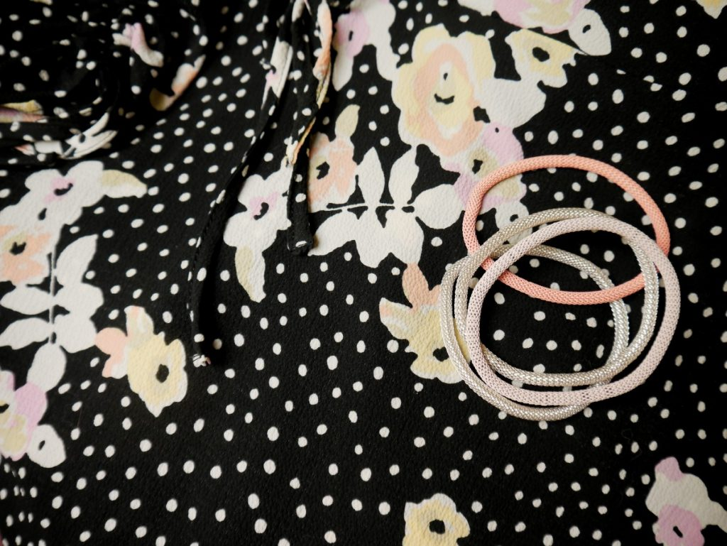 floral dress closeup with H&M metal bracelets