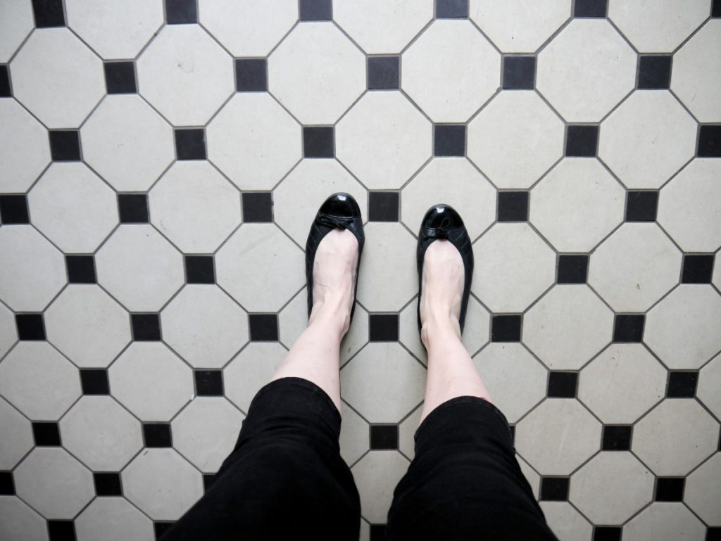 black and white tiles with ballerina flats and capri trousers