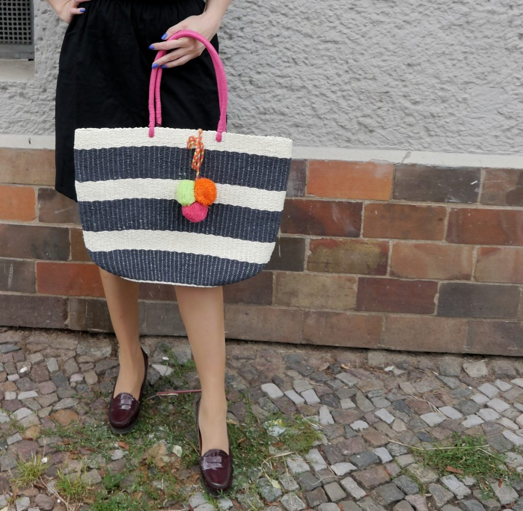 striped straw bag with fluo pom poms and Sally Hansen gel couture nail polish
