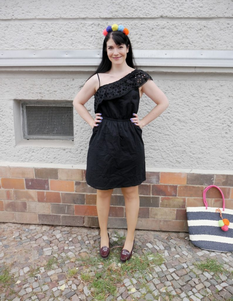 black one shoulder dress with pom pom headband