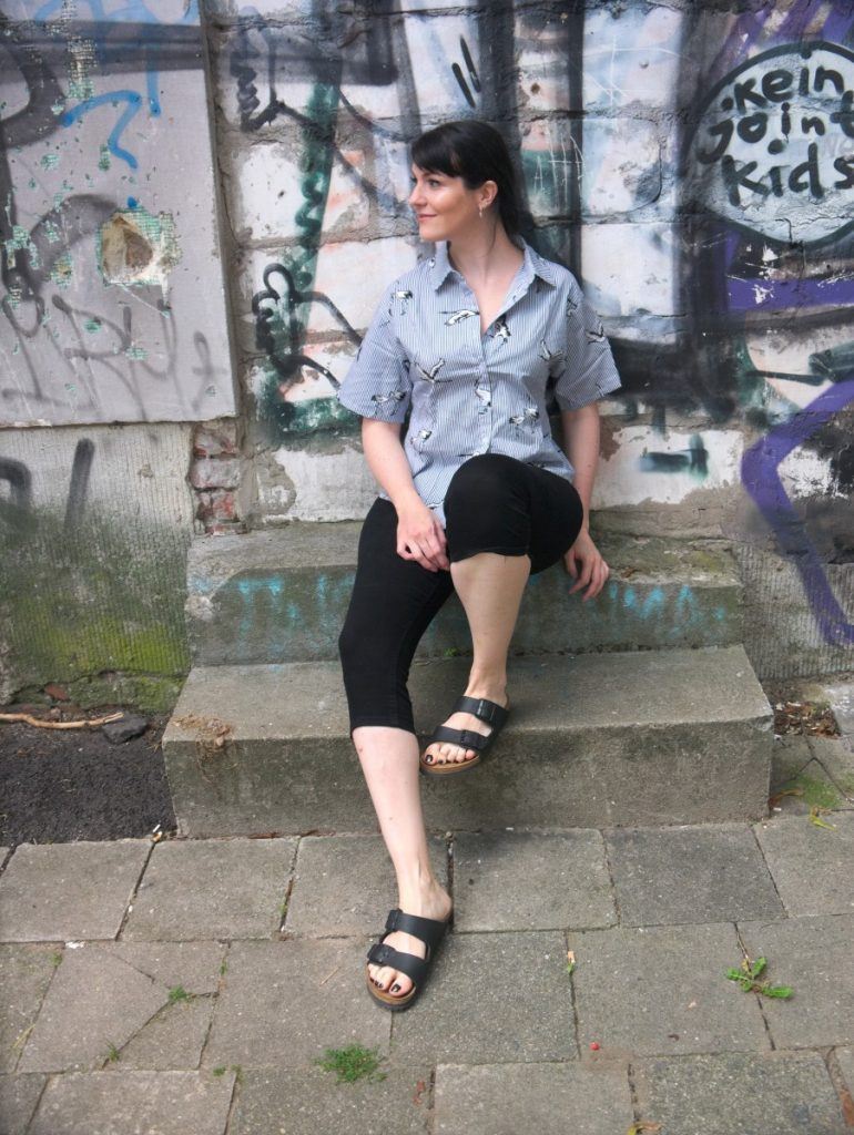 Romwe crane print blouse with stripes and Birkenstock sandals with street art wall